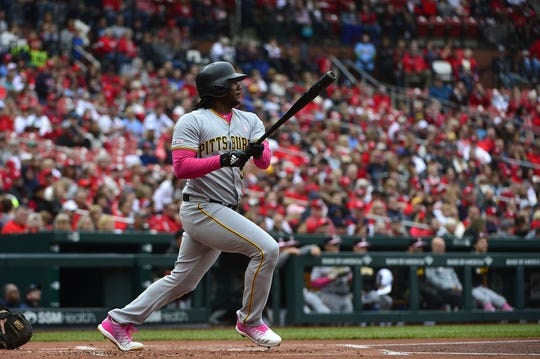 May 12, 2019; St. Louis, MO, USA; Pittsburgh Pirates first baseman Josh Bell (55) hits a two-run double off of St. Louis Cardinals starting pitcher Dakota Hudson (not pictured) during the first inning at Busch Stadium. Mandatory Credit: Jeff Curry-USA TODAY Sports
