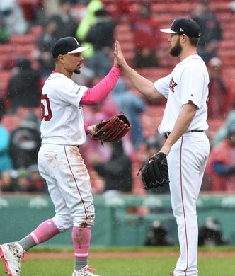 May 12, 2019; Boston, MA, USA; Boston Red Sox right fielder Mookie Betts (50) high fives starting pitcher Josh Smith (67) after defeating the Seattle Mariners at Fenway Park. Mandatory Credit: Bob DeChiara-USA TODAY Sports
