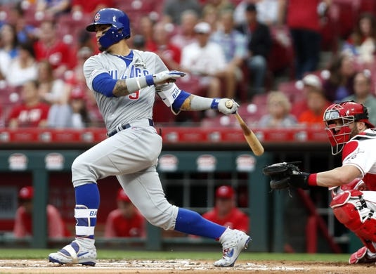 May 16, 2019; Cincinnati, OH, USA; Chicago Cubs shortstop Javier Baez (9) hits a double against the Cincinnati Reds during the first inning at Great American Ball Park. Mandatory Credit: David Kohl-USA TODAY Sports