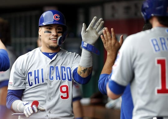 May 16, 2019; Cincinnati, OH, USA; Chicago Cubs shortstop Javier Baez (9) is congratulated in the dugout after scoring against the Cincinnati Reds during the first inning at Great American Ball Park. Mandatory Credit: David Kohl-USA TODAY Sports