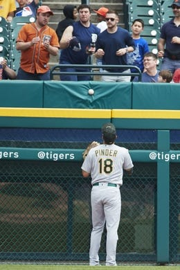 May 19, 2019; Detroit, MI, USA; Oakland Athletics left field Chad Pinder (18) watches as a ball hit by Detroit Tigers right fielder Nicholas Castellanos (not pictured) goes over the left field wall for a home run in the third inning at Comerica Park. Mandatory Credit: Rick Osentoski-USA TODAY Sports