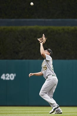 May 19, 2019; Detroit, MI, USA; Oakland Athletics right fielder Stephen Piscotty (25) makes a catch on a ball hit by Detroit Tigers third baseman Ronny Rodriguez (not pictured) in the sixth inning at Comerica Park. Mandatory Credit: Rick Osentoski-USA TODAY Sports