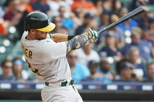 May 19, 2019; Detroit, MI, USA; Oakland Athletics left field Chad Pinder (18) hits a single in the seventh inning against the Detroit Tigers at Comerica Park. Mandatory Credit: Rick Osentoski-USA TODAY Sports