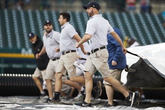 May 19, 2019; Detroit, MI, USA; Grounds crew pull the tarp onto the field during the seventh inning of thae game between the Detroit Tigers and the Oakland Athletics at Comerica Park. Mandatory Credit: Rick Osentoski-USA TODAY Sports