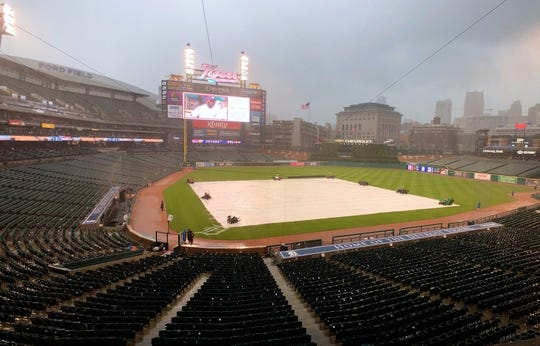 May 19, 2019; Detroit, MI, USA; A tarp covers the infield at Comerica Park during a rain delay of a game between the Detroit Tigers and the Oakland Athletics. Mandatory Credit: Rick Osentoski-USA TODAY Sports