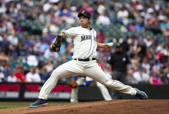May 19, 2019; Seattle, WA, USA; Seattle Mariners starting pitcher Yusei Kikuchi (18) delivers against the Minnesota Twins in the first inning at T-Mobile Park. Mandatory Credit: Lindsey Wasson-USA TODAY Sports