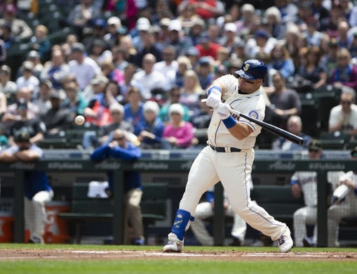 May 19, 2019; Seattle, WA, USA; Seattle Mariners designated hitter Daniel Vogelbach (20) hits a single in the second inning against the Minnesota Twins at T-Mobile Park. Mandatory Credit: Lindsey Wasson-USA TODAY Sports