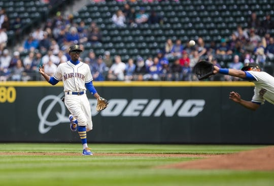 May 19, 2019; Seattle, WA, USA; Seattle Mariners second baseman Dee Gordon( 9) reacts as Seattle Mariners first baseman Edwin Encarnacion (10) flies in front of him to make a diving catch on an infield out by Minnesota Twins catcher Willians Astudillo (not pictured) at T-Mobile Park. Mandatory Credit: Lindsey Wasson-USA TODAY Sports