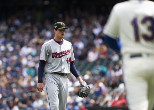 May 19, 2019; Seattle, WA, USA; Minnesota Twins starting pitcher Kyle Gibson (44) walks off the field after pitching in the first inning against the Seattle Mariners at T-Mobile Park. Mandatory Credit: Lindsey Wasson-USA TODAY Sports