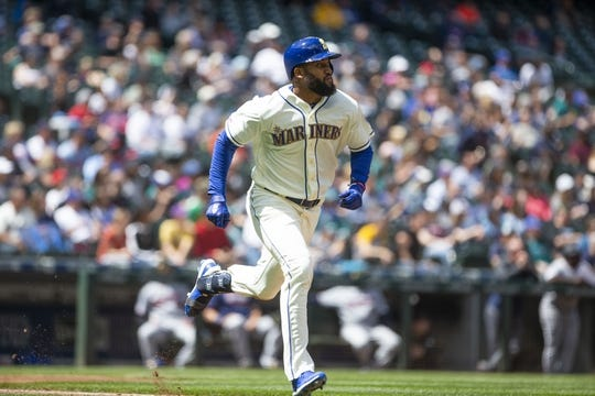 May 19, 2019; Seattle, WA, USA; Seattle Mariners left fielder Domingo Santana (16) runs out of the batter's box after hitting a double in the fourth inning against the Minnesota Twins at T-Mobile Park. Mandatory Credit: Lindsey Wasson-USA TODAY Sports