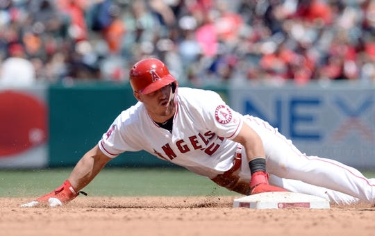 May 19, 2019; Anaheim, CA, USA; Los Angeles Angels center fielder Mike Trout (27) reaches second on a wild pitch by Kansas City Royals starting pitcher Danny Duffy (41) during the third inning at Angel Stadium of Anaheim. Mandatory Credit: Gary A. Vasquez-USA TODAY Sports