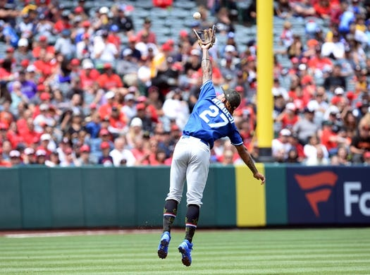 May 19, 2019; Anaheim, CA, USA; Kansas City Royals shortstop Adalberto Mondesi (27) misses fielding a hit against the Los Angeles Angels during the second inning at Angel Stadium of Anaheim. Mandatory Credit: Gary A. Vasquez-USA TODAY Sports