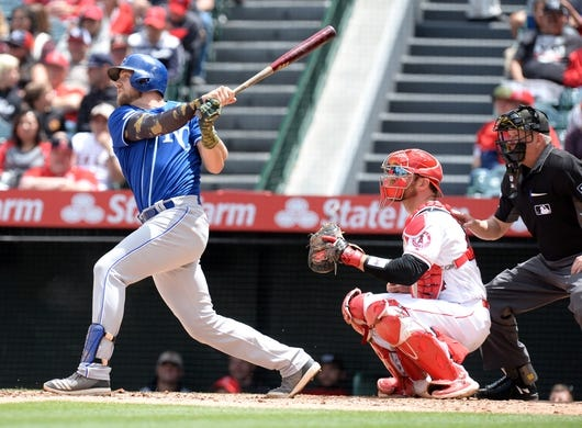 May 19, 2019; Anaheim, CA, USA; Kansas City Royals first baseman Hunter Dozier (17) hits a two run RBI double against the Los Angeles Angels during the third inning at Angel Stadium of Anaheim. Mandatory Credit: Gary A. Vasquez-USA TODAY Sports