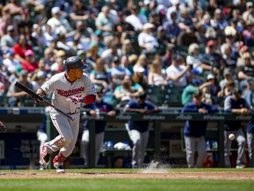 May 19, 2019; Seattle, WA, USA; Minnesota Twins shortstop Jorge Polanco (11) hits a two-run double in the fifth inning on a throwing error by Seattle Mariners starting pitcher Yusei Kikuchi (not pictured) at T-Mobile Park. Mandatory Credit: Lindsey Wasson-USA TODAY Sports