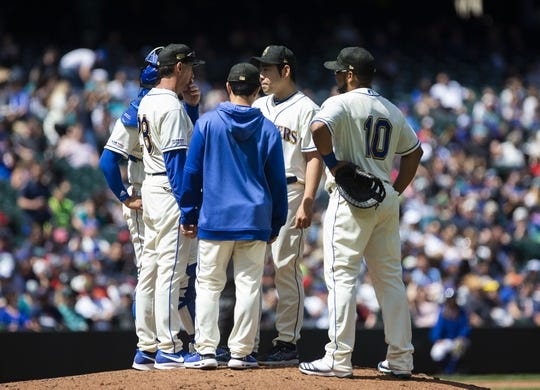 May 19, 2019; Seattle, WA, USA; Seattle Mariners pitching coach Paul Davis, left talks with Seattle Mariners starting pitcher Yusei Kikuchi (18) on the mound in the fifth inning against the Minnesota Twins at T-Mobile Park. Mandatory Credit: Lindsey Wasson-USA TODAY Sports