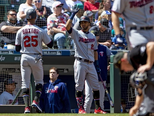 May 19, 2019; Seattle, WA, USA; Minnesota Twins center fielder Byron Buxton (25) is greeted by Minnesota Twins second baseman Luis Arraez (2) after scoring on a groundout by Minnesota Twins designated hitter Jonathan Schoop (not pictured) in the fifth inning against the Seattle Mariners at T-Mobile Park. Mandatory Credit: Lindsey Wasson-USA TODAY Sports