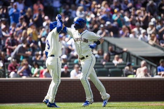 May 19, 2019; Seattle, WA, USA; Seattle Mariners right fielder Mitch Haniger (17) celebrates his two run home run with Seattle Mariners shortstop J.P. Crawford (3) in the fifth inning against the Minnesota Twins at T-Mobile Park. Mandatory Credit: Lindsey Wasson-USA TODAY Sports