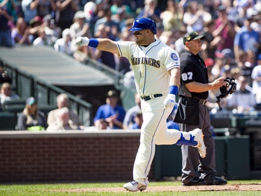 May 19, 2019; Seattle, WA, USA; Seattle Mariners designated hitter Daniel Vogelbach (20) points to his teammates after hitting a home run in the fifth inning against the Minnesota Twins at T-Mobile Park. Mandatory Credit: Lindsey Wasson-USA TODAY Sports