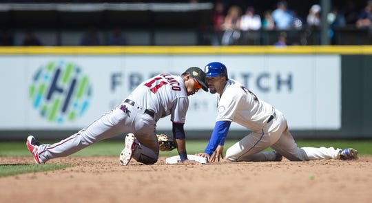 May 19, 2019; Seattle, WA, USA; Minnesota Twins shortstop Jorge Polanco (11) and Seattle Mariners shortstop J.P. Crawford (3) look back at the umpire for the call at second base after Crawford was caught stealing in the sixth inning at T-Mobile Park. Mandatory Credit: Lindsey Wasson-USA TODAY Sports