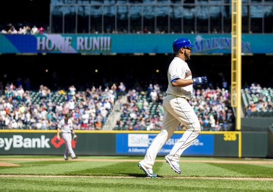 May 19, 2019; Seattle, WA, USA; Seattle Mariners first baseman Edwin Encarnacion (10) jogs home after hitting a three-run home run in the seventh inning against the Minnesota Twins at T-Mobile Park. Mandatory Credit: Lindsey Wasson-USA TODAY Sports
