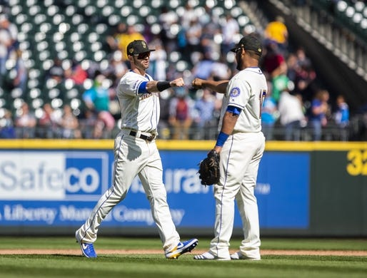 May 19, 2019; Seattle, WA, USA; Seattle Mariners right fielder Mitch Haniger (17) greets Seattle Mariners first baseman Edwin Encarnacion (10) after their 7-4 win over the Minnesota Twins at T-Mobile Park. Mandatory Credit: Lindsey Wasson-USA TODAY Sports
