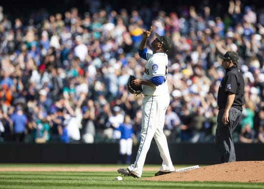 May 19, 2019; Seattle, WA, USA; Seattle Mariners relief pitcher Roenis Elias (55) points to the sky after getting the victory over the Minnesota Twins at T-Mobile Park. Mandatory Credit: Lindsey Wasson-USA TODAY Sports