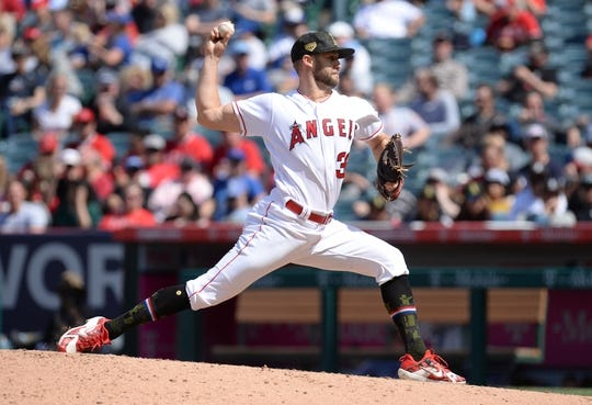 May 19, 2019; Anaheim, CA, USA; Los Angeles Angels relief pitcher Luke Bard (39) throws against the Kansas City Royals during the seventh inning at Angel Stadium of Anaheim. Mandatory Credit: Gary A. Vasquez-USA TODAY Sports