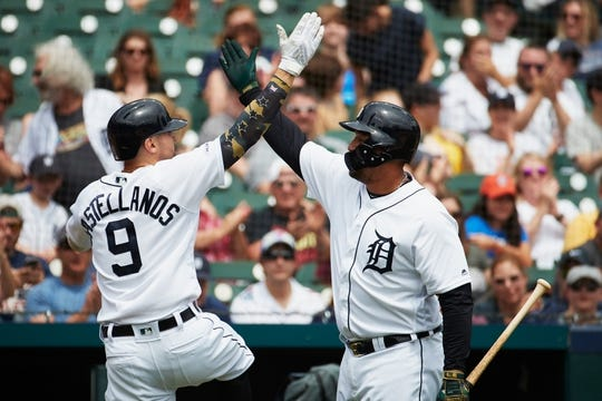 May 19, 2019; Detroit, MI, USA; Detroit Tigers right fielder Nicholas Castellanos (9) receives congratulations from designated hitter Miguel Cabrera (24) after he hits a home run in the third inning against the Oakland Athletics at Comerica Park. Mandatory Credit: Rick Osentoski-USA TODAY Sports