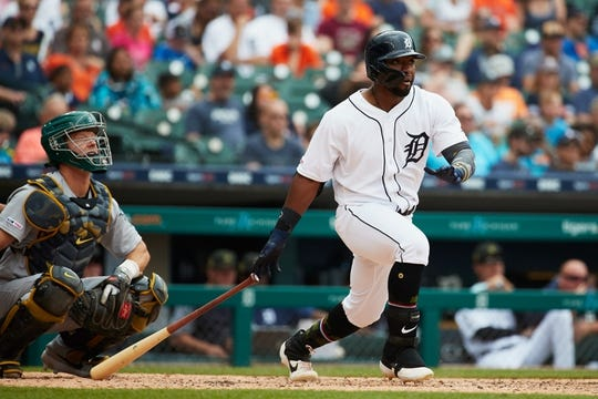 May 19, 2019; Detroit, MI, USA; Detroit Tigers left fielder Christin Stewart (14) at bat against the Oakland Athletics at Comerica Park. Mandatory Credit: Rick Osentoski-USA TODAY Sports