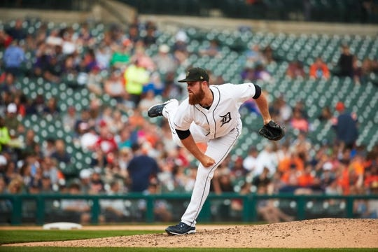 May 19, 2019; Detroit, MI, USA; Detroit Tigers relief pitcher Buck Farmer (45) pitches against the Oakland Athletics at Comerica Park. Mandatory Credit: Rick Osentoski-USA TODAY Sports
