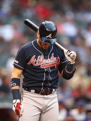 May 9, 2019; Phoenix, AZ, USA; Atlanta Braves third baseman Josh Donaldson reacts against the Arizona Diamondbacks at Chase Field. Mandatory Credit: Mark J. Rebilas-USA TODAY Sports