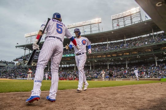 May 21, 2019; Chicago, IL, USA; Chicago Cubs third baseman Kris Bryant (17) celebrates with center fielder Albert Almora Jr. (5) after scoring during the first inning against the Philadelphia Phillies at Wrigley Field. Mandatory Credit: Patrick Gorski-USA TODAY Sports