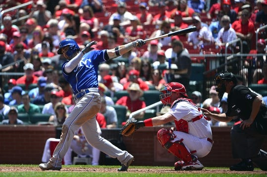 May 22, 2019; St. Louis, MO, USA; Kansas City Royals center fielder Whit Merrifield (15) hits a one run double off of St. Louis Cardinals starting pitcher Michael Wacha (not pictured) during the third inning at Busch Stadium. Mandatory Credit: Jeff Curry-USA TODAY Sports