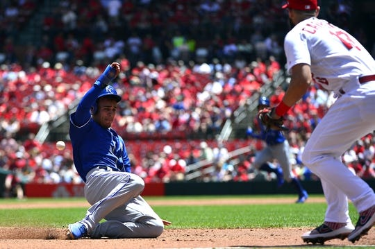 May 22, 2019; St. Louis, MO, USA; Kansas City Royals second baseman Nicky Lopez (1) slides safely in to third on a single by shortstop Adalberto Mondesi (not pictured) during the third inning against the St. Louis Cardinals at Busch Stadium. Mandatory Credit: Jeff Curry-USA TODAY Sports