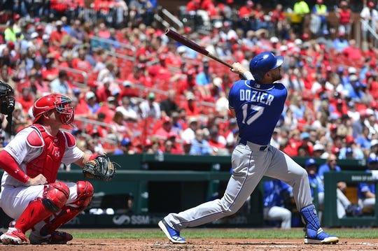 May 22, 2019; St. Louis, MO, USA; Kansas City Royals third baseman Hunter Dozier (17) hits a sacrifice fly off of St. Louis Cardinals starting pitcher Michael Wacha (not pictured) during the second inning at Busch Stadium. Mandatory Credit: Jeff Curry-USA TODAY Sports