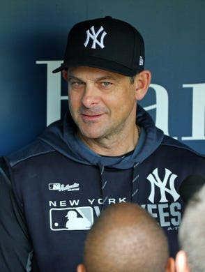 May 25, 2019; Kansas City, MO, USA; New York Yankees manager Aaron Boone (17) talks with reporters before the first game of a double header against the Kansas City Royals at Kauffman Stadium. Mandatory Credit: Jay Biggerstaff-USA TODAY Sports
