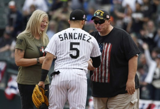 May 27, 2019; Chicago, IL, USA; Chicago White Sox second baseman Yolmer Sanchez (5) signs an autograph for a Gold Star family before a game against the Kansas City Royals at Guaranteed Rate Field. Mandatory Credit: David Banks-USA TODAY Sports