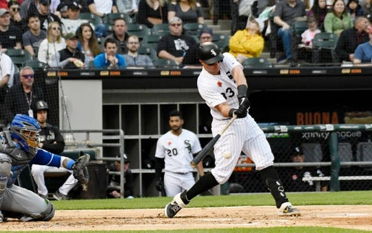 May 27, 2019; Chicago, IL, USA; Chicago White Sox catcher James McCann (33) hits a single against the Kansas City Royals during the second inning at Guaranteed Rate Field. Mandatory Credit: David Banks-USA TODAY Sports