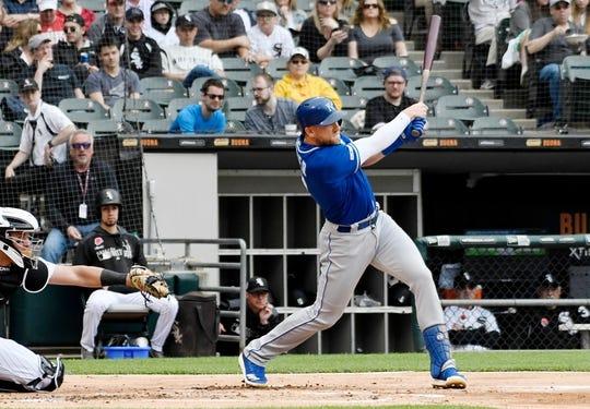 May 27, 2019; Chicago, IL, USA; Kansas City Royals third baseman Hunter Dozier (17) hits a single against the Chicago White Sox during the second inning at Guaranteed Rate Field. Mandatory Credit: David Banks-USA TODAY Sports