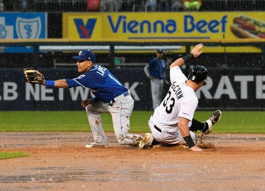May 27, 2019; Chicago, IL, USA; Chicago White Sox catcher James McCann (33) is safe at second base as Kansas City Royals second baseman Nicky Lopez (1) gets a late throw during the fifth inning at Guaranteed Rate Field. Mandatory Credit: David Banks-USA TODAY Sports