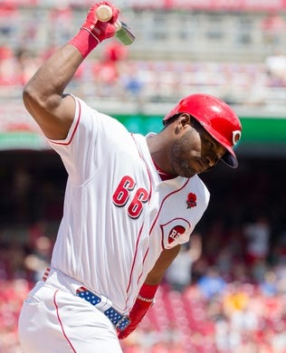 Cincinnati Reds right fielder Yasiel Puig (66) throws his bat  in the fourth inning of the MLB National League game between Cincinnati Reds and Pittsburgh Pirates at Great American Ball Park in Cincinnati on Monday, May 27, 2019.   Pittsburgh Pirates At Cincinnati Reds