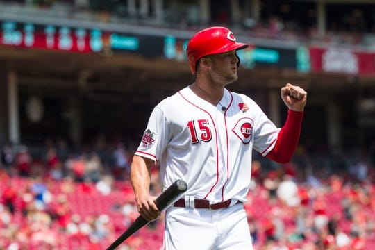 Cincinnati Reds third baseman Nick Senzel (15) celebrates after scoring on an RBI double in the fifth inning of the MLB National League game between Cincinnati Reds and Pittsburgh Pirates at Great American Ball Park in Cincinnati on Monday, May 27, 2019.   Pittsburgh Pirates At Cincinnati Reds