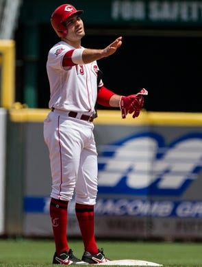 Cincinnati Reds first baseman Joey Votto (19) reacts to the base coach after hitting an RBI double in the fifth inning of the MLB National League game between Cincinnati Reds and Pittsburgh Pirates at Great American Ball Park in Cincinnati on Monday, May 27, 2019.   Pittsburgh Pirates At Cincinnati Reds
