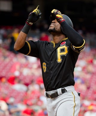 Pittsburgh Pirates center fielder Starling Marte (6) celebrates after hitting a 2-run home run in the eighth inning of the MLB National League game between Cincinnati Reds and Pittsburgh Pirates at Great American Ball Park in Cincinnati on Monday, May 27, 2019.   Pittsburgh Pirates At Cincinnati Reds