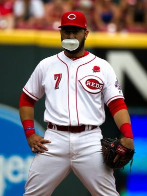 Cincinnati Reds third baseman Eugenio Suarez (7) blows a bubble in the eighth inning of the MLB National League game between Cincinnati Reds and Pittsburgh Pirates at Great American Ball Park in Cincinnati on Monday, May 27, 2019. Pittsburgh Pirates defeated Cincinnati Reds 8-5.  Pittsburgh Pirates At Cincinnati Reds