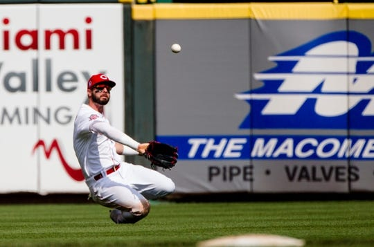 Cincinnati Reds right fielder Jesse Winker (33) catches a fly ball in the ninth inning of the MLB National League game between Cincinnati Reds and Pittsburgh Pirates at Great American Ball Park in Cincinnati on Monday, May 27, 2019.   Pittsburgh Pirates At Cincinnati Reds
