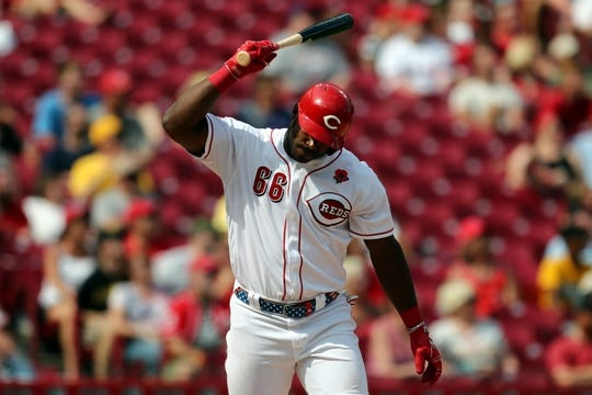 May 27, 2019; Cincinnati, OH, USA; Cincinnati Reds right fielder Yasiel Puig (66) throws his bat as he flies out against the Pittsburgh Pirates in the eighth inning at Great American Ball Park. Mandatory Credit: Aaron Doster-USA TODAY Sports