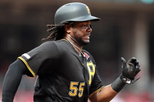 May 27, 2019; Cincinnati, OH, USA; Pittsburgh Pirates first baseman Josh Bell (55) runs to first base against the Cincinnati Reds in the eighth inning at Great American Ball Park. Mandatory Credit: Aaron Doster-USA TODAY Sports