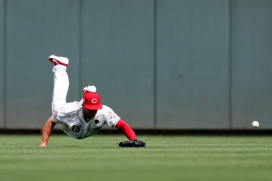 May 27, 2019; Cincinnati, OH, USA; Cincinnati Reds third baseman Nick Senzel (15) dives and is unable to catch a ball hit by Pittsburgh Pirates shortstop Cole Tucker (3) in the eighth inning at Great American Ball Park. Mandatory Credit: Aaron Doster-USA TODAY Sports