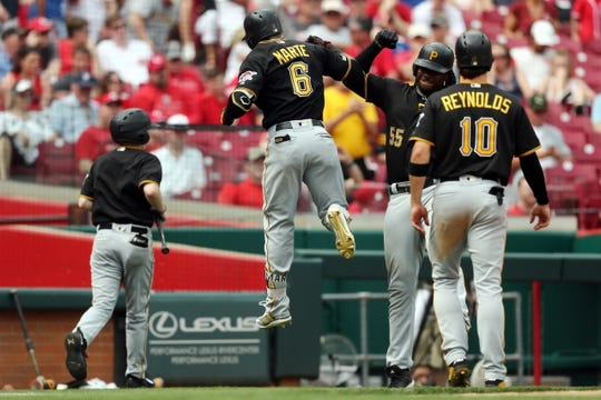 May 27, 2019; Cincinnati, OH, USA; Pittsburgh Pirates center fielder Starling Marte (6) celebrates hitting a two-run home run with first baseman Josh Bell (55) in the game against the Cincinnati Reds in the eighth inning at Great American Ball Park. Mandatory Credit: Aaron Doster-USA TODAY Sports